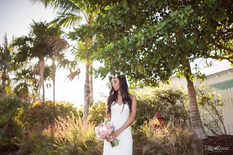 bride posing with beautiful foliage at sunset key key west florida