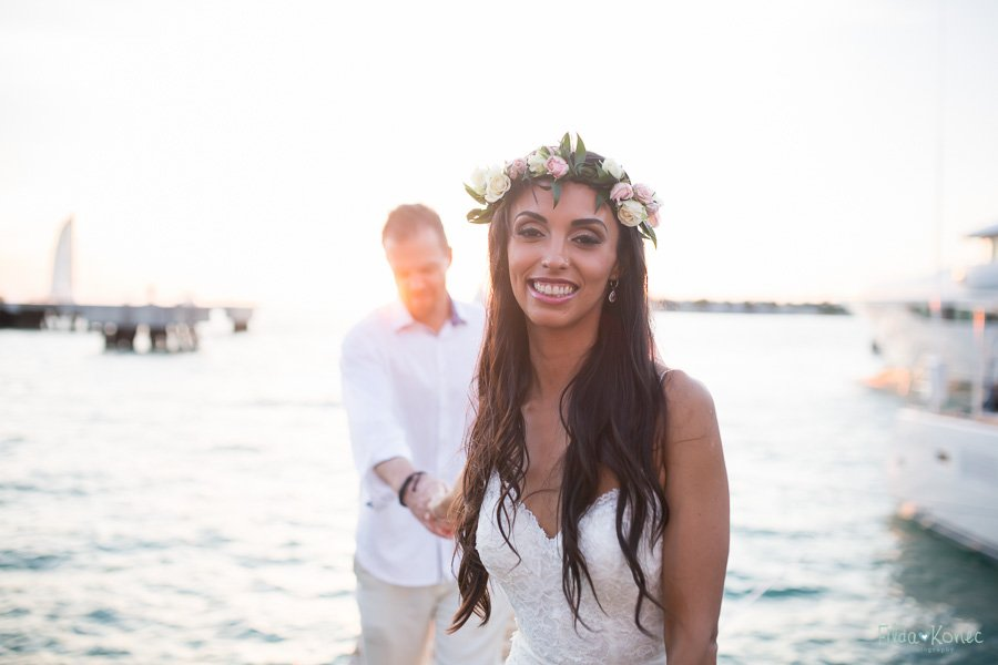 bride with her groom on the pier during sunset in key west florida