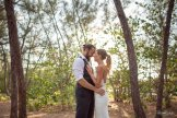 bride and groom posing in the woods at fort zachary in key west florida