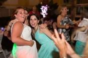 girls at wedding reception posing for photo