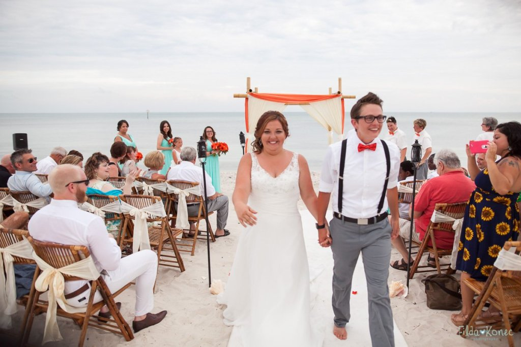 bride and groom recessional at their key west beach wedding