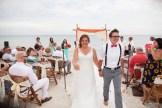 bride and groom recessional at their key west beach wedding