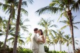 bride and groom with palm trees at sunset key