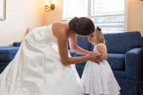 bride hugs little girl