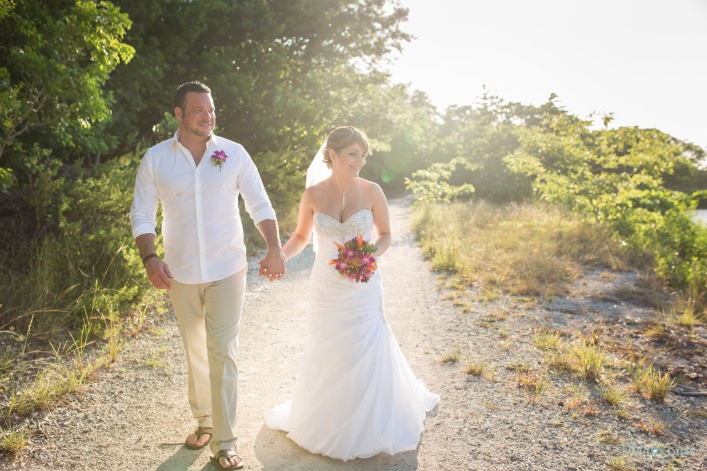 wedding couple walks down the trail on their wedding day