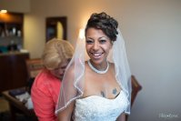 Bride is getting ready in a hotel room at Sheraton Suites