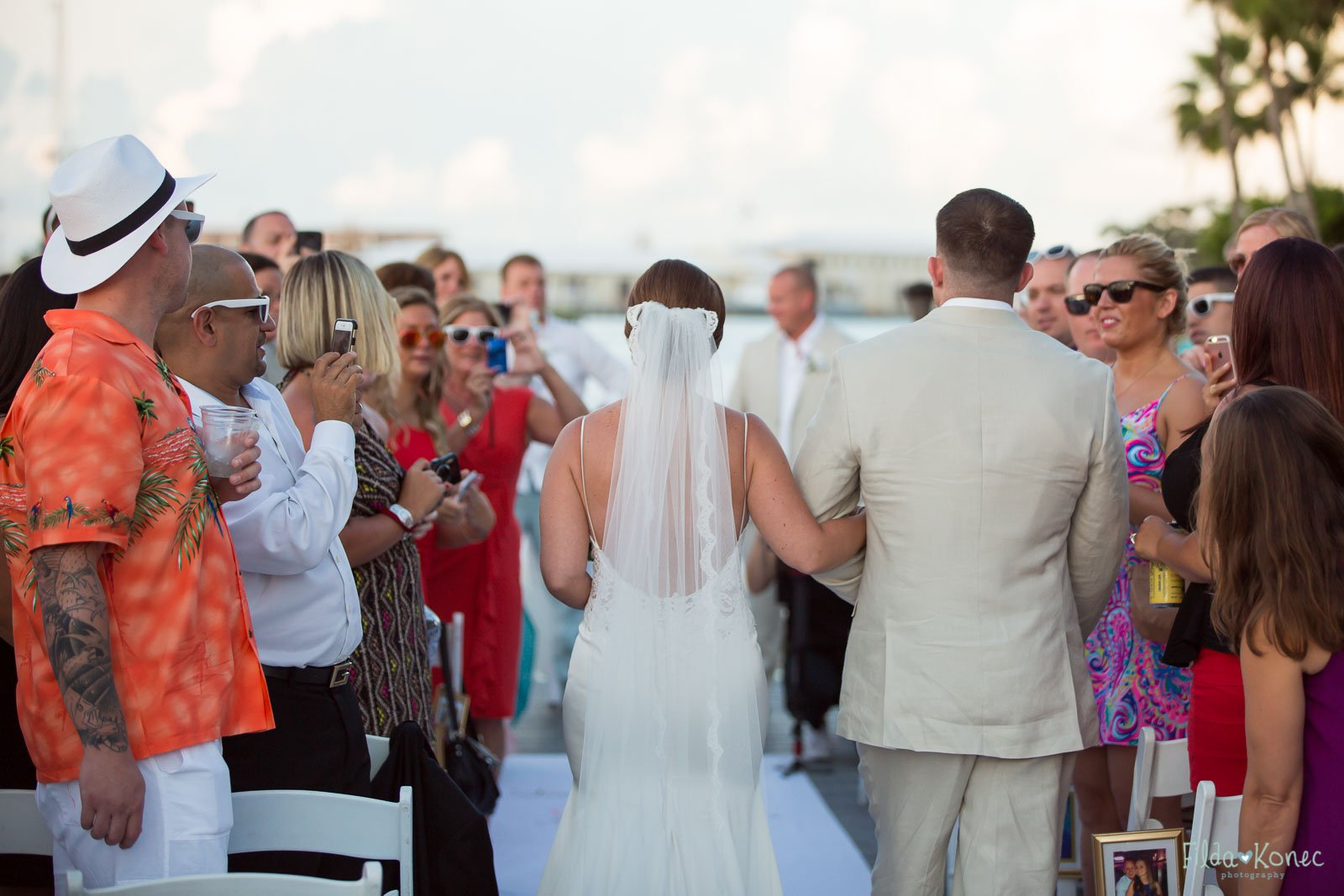 bride walks down the isle with her brother