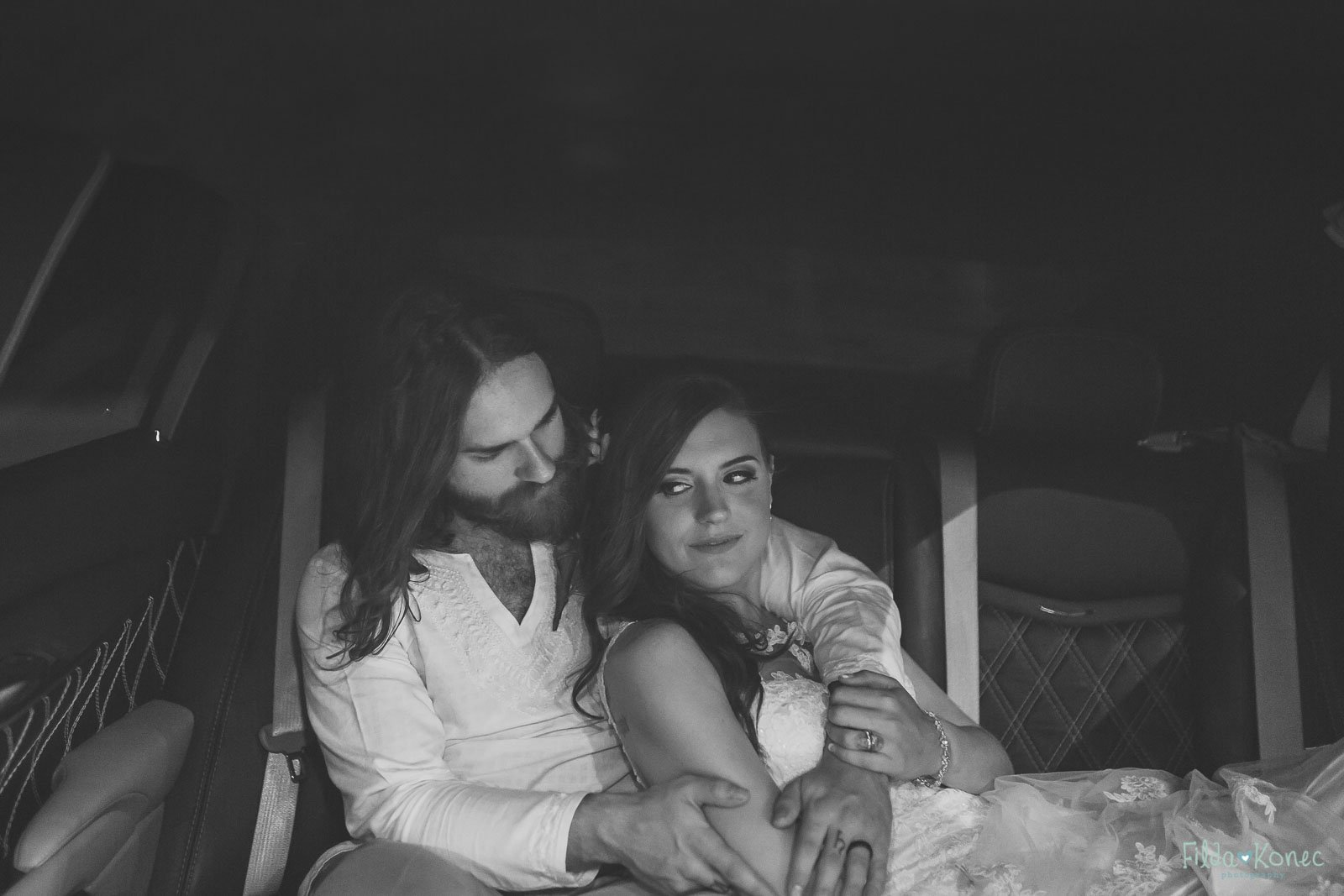 couple cuddling in a limo at their wedding in key west
