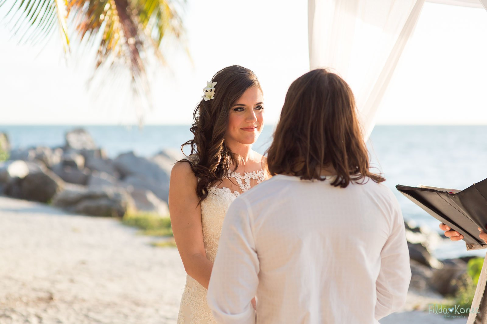 bride during beach ceremony at fort zachary taylor in key west florida