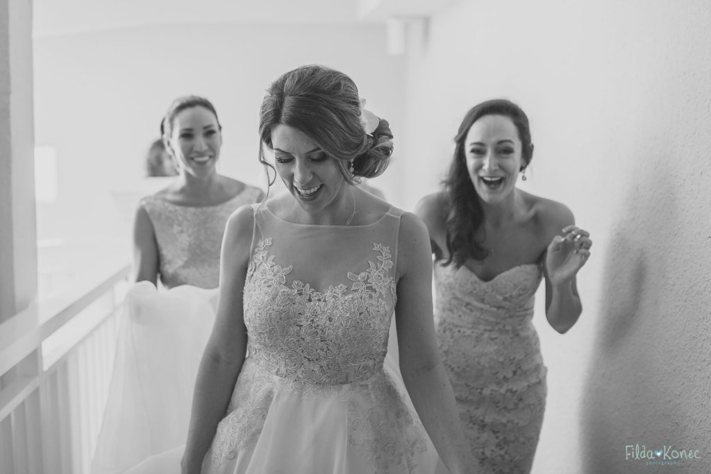 bride and her bridesmaids walking to the ceremony