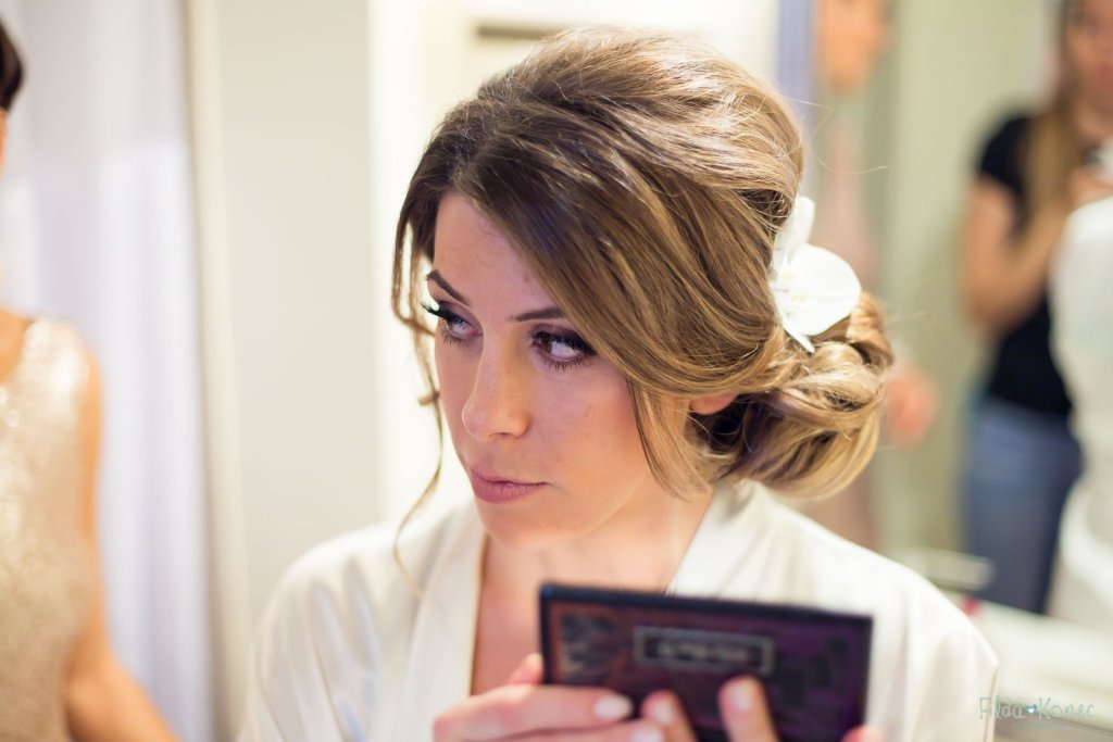 bride checking her makeup