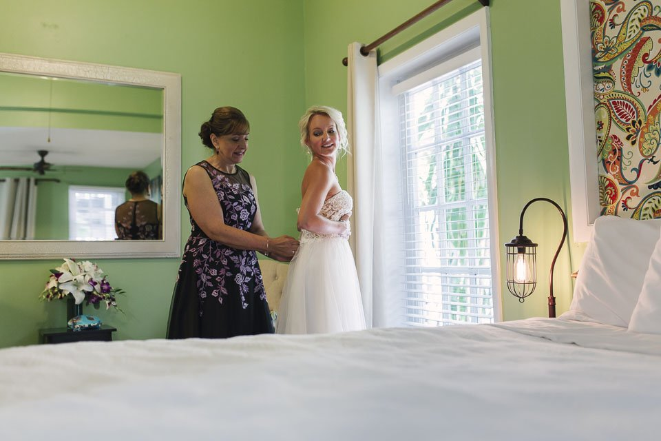 bride putting her dress on at old town manor