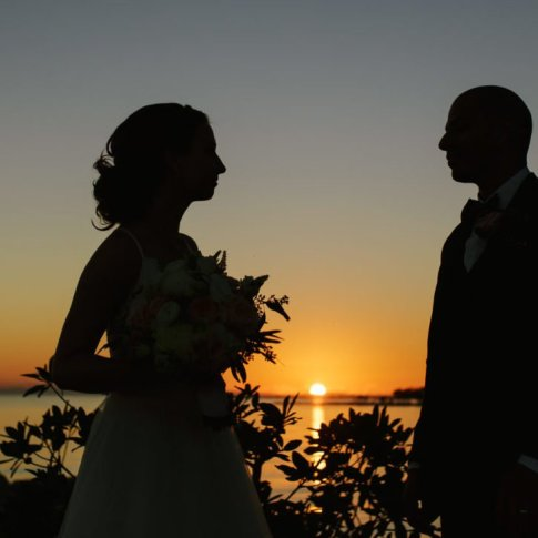 married couple at key west beach with sunset