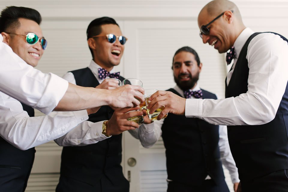 groom with groomsmen having a drink