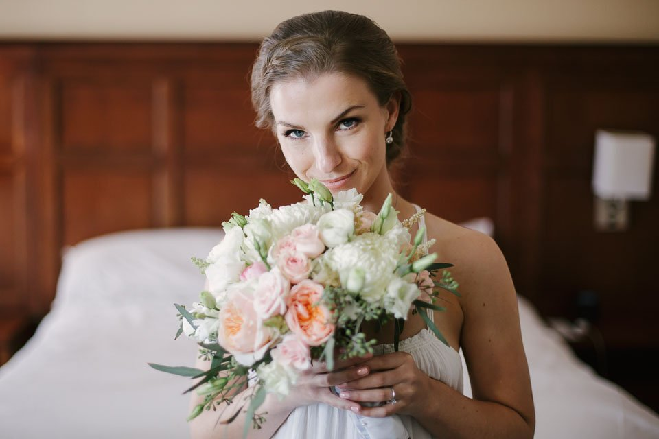 bride with flowers at her sheraton wedding