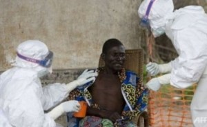 Nurses treat a patient with Ebola hemorrhagic fever in this AFP file photo.