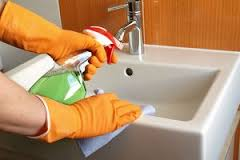 washing a faucet