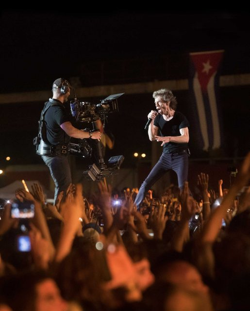 "Mick Jagger and Camera Operator Dominic Jackson on stage in almost matching wardrobe, Sachtler artemis sled, Walter Klassen Rear mounted vest, Steadicam G-70 Arm, Sony F55, Canon 17-120 lens, TransvideoCineMonitorHD 6"", Anton/Bauer batteries."