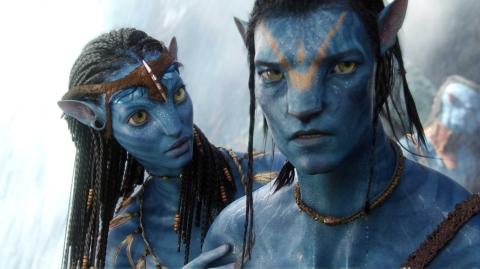 Neyteri (Zoe Saldana) and Jake Sully (Sam Worthington) in a scene from 'Avatar' / Photo credit: WETA & 20th Century Fox