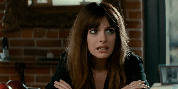COLOSSAL: Anne Hathaway Towers Over An Uneven Landscape