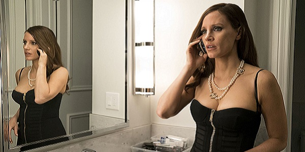 MOLLY'S GAME: Chastain on the phone in front of mirror