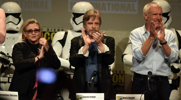 SAN DIEGO, CA - JULY 10:  (L-R) Actors Carrie Fisher, Mark Hamill and Harrison Ford applaud onstage at the Lucasfilm panel during Comic-Con International 2015 at the San Diego Convention Center on July 10, 2015 in San Diego, California.  (Photo by Kevin Winter/Getty Images)