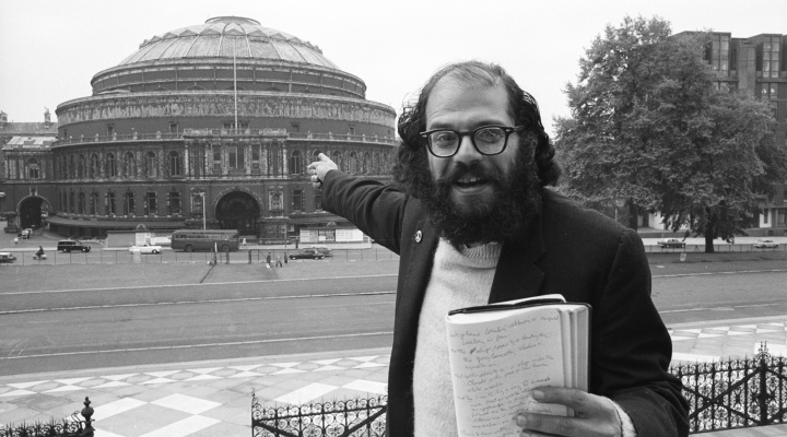 London early June  1965 In town for International Poetry Congress at Royal Albert Hall. Allen Ginsberg with journal, Albert Hall in background.