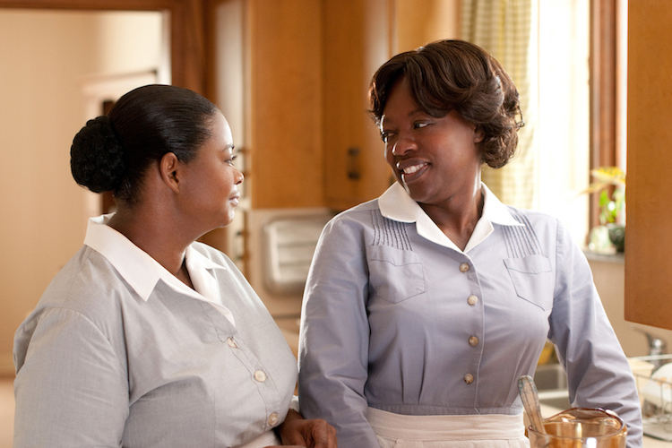 """""""THE HELP"""" TH-076R Minny Jackson (Octavia Spencer, left) shares a laugh with her best friend Aibileen Clark (Academy Award® nominee Viola Davis, right), in DreamWorks Pictures' inspiring drama, """"The Help,"""" based on the New York Times best-selling novel by Kathryn Stockett. """"The Help"""" is written for the screen and directed by Tate Taylor, with Brunson Green, Chris Columbus and Michael Barnathan producing. Ph: Dale Robinette ©DreamWorks II Distribution Co., LLC. All Rights Reserved."""