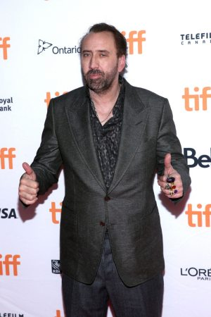 2017 Nicolas Cage at Tiff throwing thumbs up to the crowd looking incredibly drunk.