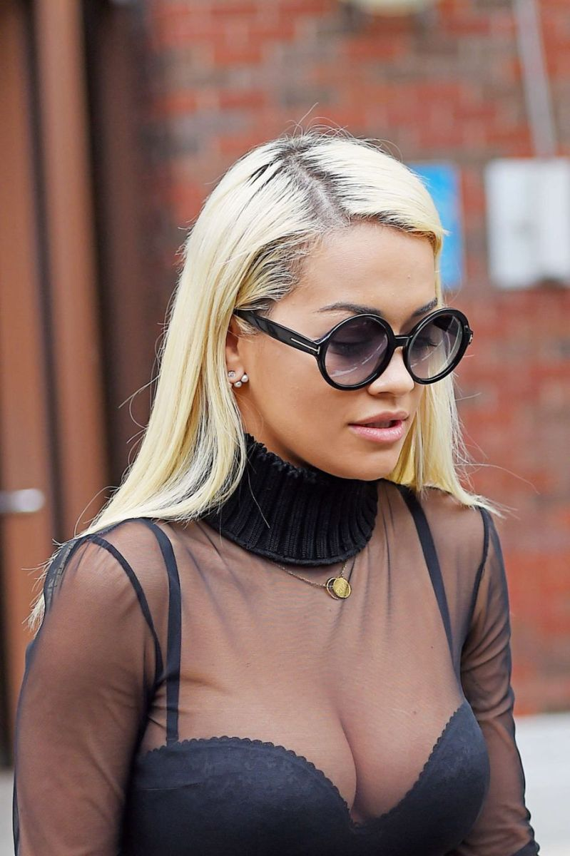 Rita Ora Flashes Major Cleavage in Racy Sheer Black Top