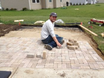 A paver patio can transform a boring backyard into an outdoor oasis. Follow this step-by-step guide to build a paver patio in your backyard on any budget.