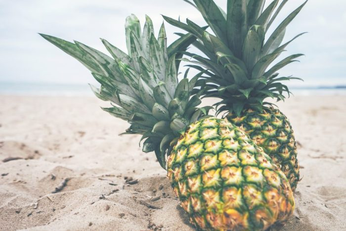 Pineapples in sand