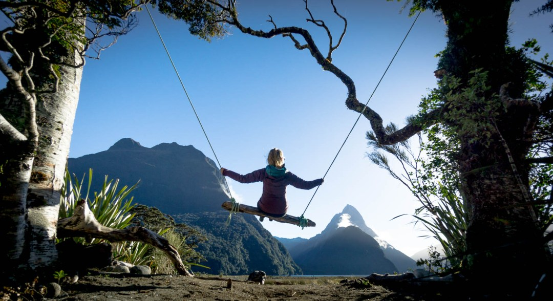 Hilary on swing in Milford Sound