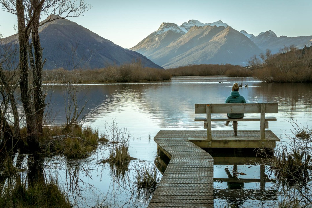 Sitting on a bench at Glenorchy Lagoon walking trail