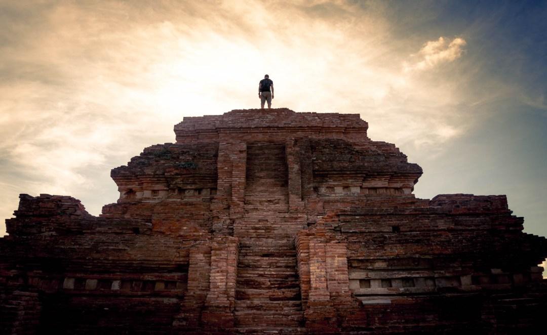 Ben standing on top of crumbling temple
