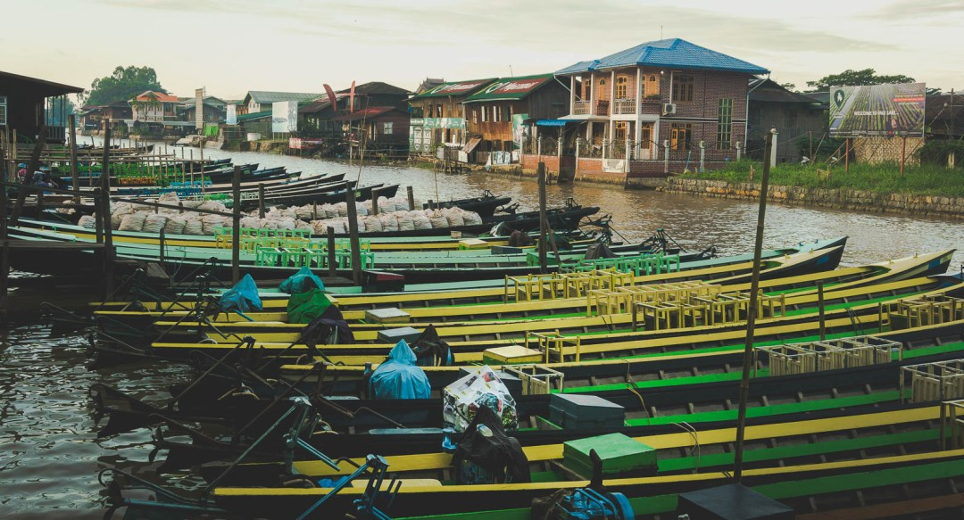 Long boats parked in Inle Lake