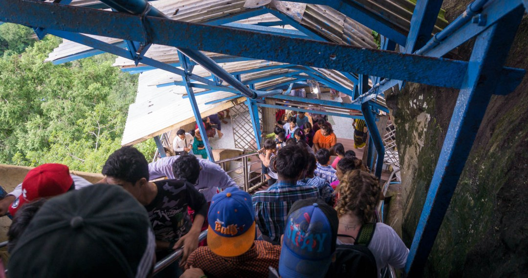 Stairway to the top of mount Popa crowded with people