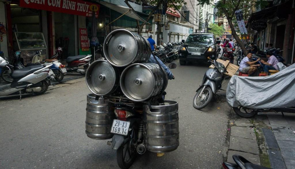 Motorbike carrying kegs of Bia Hoi Beer