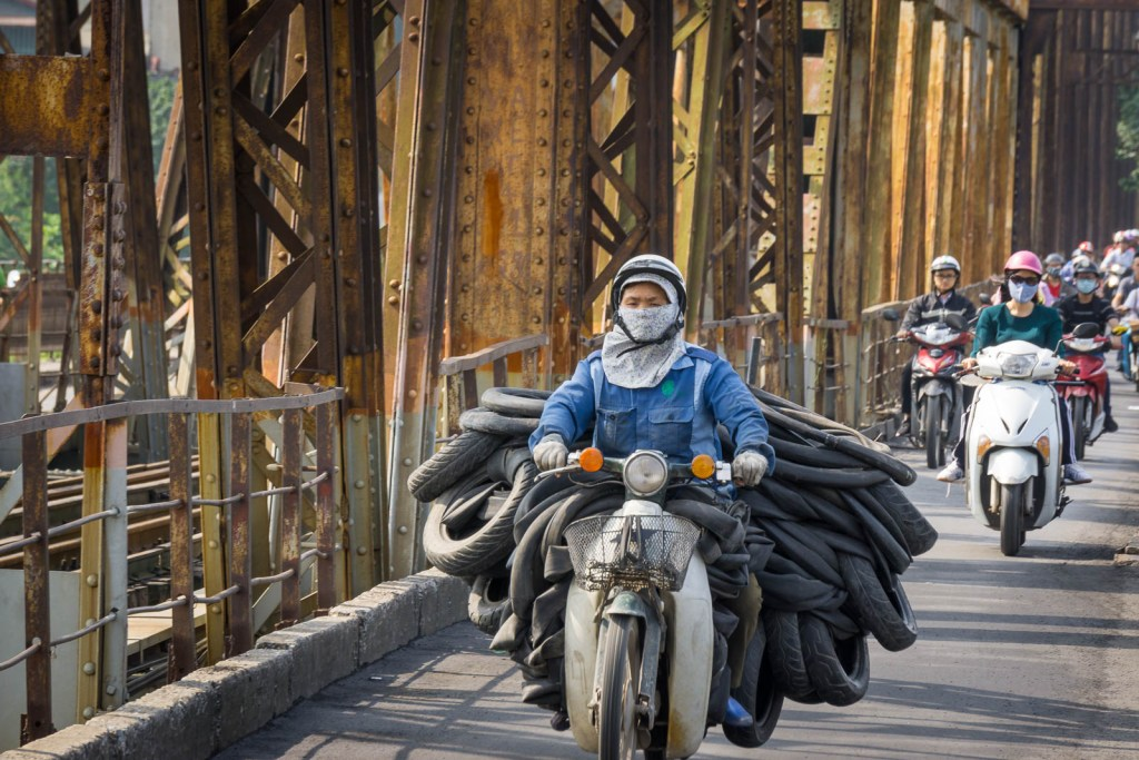 Motorbike carrying tires and tubes in Vietnam
