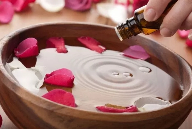 Essential Oil, Rosewater And Warm Water Foot Bath