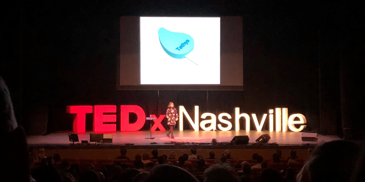 Image of 12 year old Gitanjali Rao speaking on stage at TEDx Nashville about her mission to tackle the global water crisis.