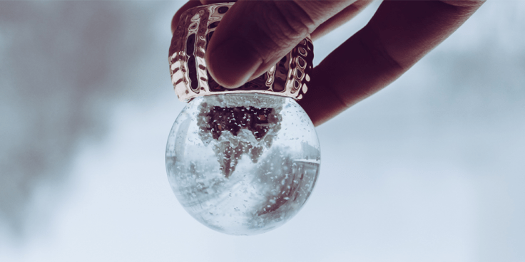 Image of snow globe turned upside down to reflect thoughts in the mind.