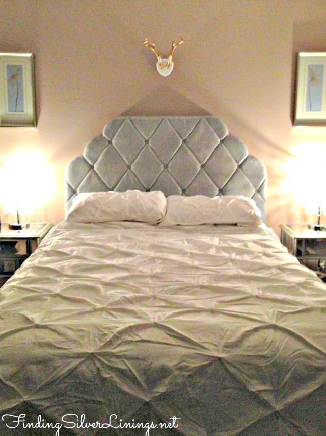 Tufted headboard and floofy bedding