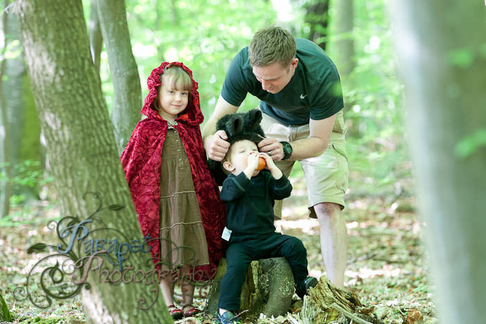 Setting the scene for a children's red riding hood photo shoot