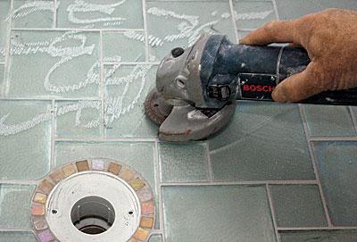can i tile over a tiled shower pan