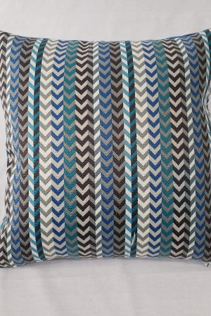 A blue chevron cut velvet cushion used as a product image