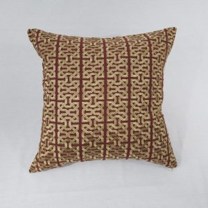 A gold and burgundy embroidered cushion