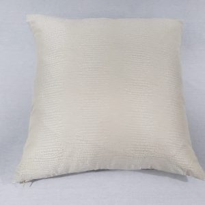A snake skin cream cushion with cream background