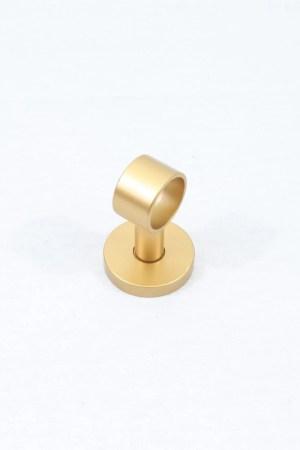 A gold ceiling loop drapery hardware bracket