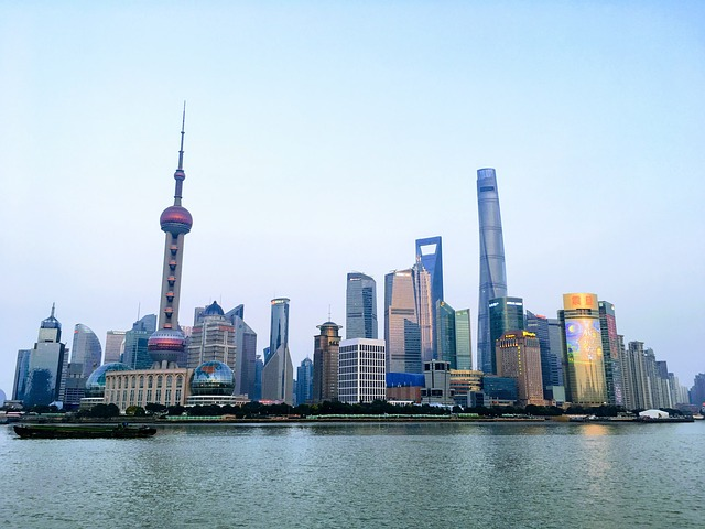 Shanghai skyline above the water.